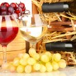 Stock Photo: Wooden case with wine bottle, barrel, wineglasses and grape close up