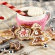 Cup of coffee with Christmas sweetness on plaid close-up — Stock Photo #19307239
