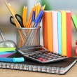 Stock Photo: School supplies on wooden table