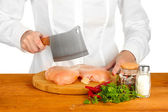 Chef cooking meat on wooden table — Stock Photo