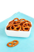 Tasty pretzels in white bowl isolated on white — Stock Photo