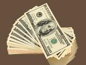 Molti di Close-up banconote cento dollari su sfondo grigio — Foto Stock