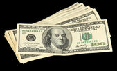 Stack of one hundred dollars banknotes close-up isolated on black — Stock Photo