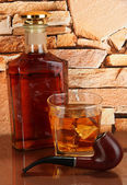 Bottle and Glass of whiskey and snorkel on brick wall background — Stock Photo