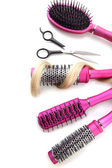 Comb brushes, hair and cutting shears, isolated on white — Stock Photo