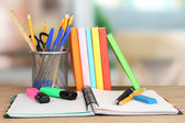 School supplies and books on wooden table — Stock Photo