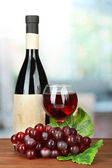 Composition of wine bottle, glass and grape, on bright background — Stock Photo
