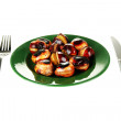 Roasted chestnuts in the green plate with fork and knife isolated on white — Stock Photo