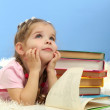 Cute little girl with colorful books, on blue background — Stock Photo #19338617