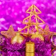 Christmas composition with candles and decorations in purple and gold colors on bright background — Stock Photo