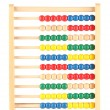 Bright wooden toy abacus, isolated on white — Stock Photo