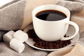 Cup of coffee with scarf close-up — Stok fotoğraf