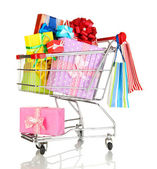 Christmas gifts and shopping in trolley isolated on white — Stock Photo