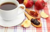 Light breakfast with tea and homemade jam, on tablecloth — Stockfoto