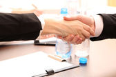 Business shaking hands, on office background — Stock Photo
