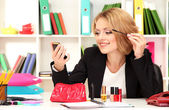 Beautiful young business woman smarten in office — Stockfoto