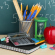 School supplies on wooden table — Stock Photo