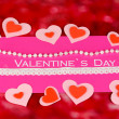 Greeting card for Valentine's Day on red background — Stock Photo
