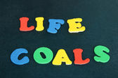 Phrase LIFE GOALS in colorful letters on school board close-up — Stock Photo
