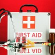 First aid box, on red background — Stock Photo #19368547