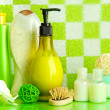 Bath accessories on shelf in bathroom on green tile wall background — Stok fotoğraf