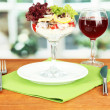Delicatessen seafood salad with rice in glass on bright background — Stock Photo