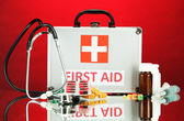First aid box, on red background — 图库照片