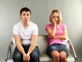 Young couple quarreling on grey background — Stock Photo
