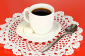 A cup of strong coffee on red background — Zdjęcie stockowe