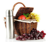 Picnic basket with fruit and thermos isolated on white — Stock Photo
