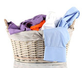 Bright clothes in laundry basket, isolated on white — Foto de Stock