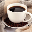 Cup of coffee with scarf close-up - Stock Photo
