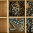Wooden box for metal bolts, screws and nuts close up - Photo