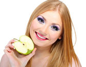 Beautiful young woman with glamour make up and apple, isolated on white — Stockfoto