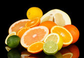 Lots ripe citrus isolated on black — Stock Photo