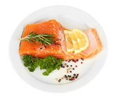 Fresh salmon fillet with herbals and lemon slices on plate, isolated on white — Stock Photo