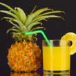 Ripe pineapple and juice glass isolated on black — Stock Photo