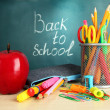 Back to school - blackboard with pencil-box and school equipment on table - Foto de Stock