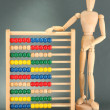 Bright toy abacus and wooden dummy, on grey background - Foto Stock