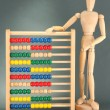 Bright toy abacus and wooden dummy, on grey background - Lizenzfreies Foto