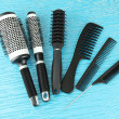 Black combs on color background — Stock Photo #19447055