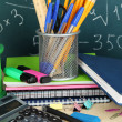 School supplies on wooden table - Foto Stock