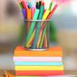 School supplies with books on wooden table — Stockfoto