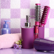Royalty-Free Stock Photo: Hair brushes, hairdryer and cosmetic bottles in bathroom