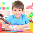 Cute little boy drawing in his album — Stock Photo