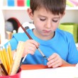 Cute little boy painting in his album — Stock Photo #19447511