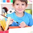 Cute little boy painting in his album — Stock Photo #19447513