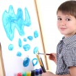 Little boy painting paints picture on easel isolated on white — Stock Photo #19447575
