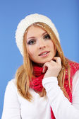Young beautiful woman with snow on blue background — Stock Photo