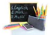 Pencil box with school equipment and timetable isolated on white — Stock Photo